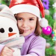 Little girl in Santa hat — Stock Photo #33152651