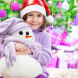 Little girl on Christmas celebration — Stockfoto
