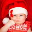 Little baby in Santa hat — Stock Photo