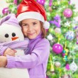 Stock Photo: Happy girl with snowman toy