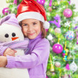 Happy girl with snowman toy — Stock Photo