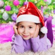 Little girl near Christmas tree — Stok fotoğraf