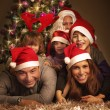 Happy family on Christmas eve — Stock Photo
