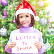Stock Photo: Little girl with letter to SantClaus
