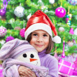 Little happy girl on Christmas party — Lizenzfreies Foto