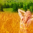Cute girl on wheat field — Stock Photo