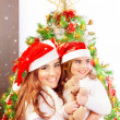 Mother with daughter celebrate Christmas — 图库照片