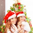 Mother with daughter celebrate Christmas — Lizenzfreies Foto