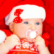 Stock Photo: Newborn girl wearing Santa hat