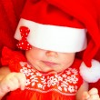 Sweet child wearing Santa hat — Stock Photo