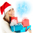 Santa girl with gifts — Stock Photo #35018955