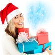 Santa girl with gifts — Stockfoto