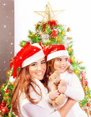 Mother with daughter celebrate Christmas — Stock Photo