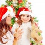 Happy family near Christmas tree — Stock Photo #35020673