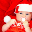 Newborn girl wearing Santa hat — Stock Photo