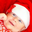 Newborn girl on Christmastime — Stock Photo #35517913