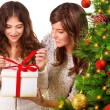 Stock Photo: Opening Christmas gift
