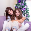 Mother with daughter on Christmas eve — Stok fotoğraf