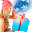 Cute woman getting Xmas gift — Stock Photo