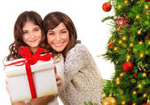 Happy mother and daughter on Xmas eve — Stock Photo