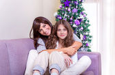 Mother with daughter on Christmas eve — Stock Photo