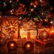 Christmas gifts under tree — Stockfoto