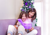 Opening Christmastime gift — Stock Photo