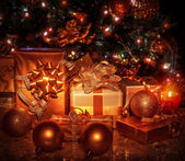 Christmas gifts under tree — Stock Photo