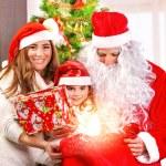 Receive Christmas present — Stock Photo #36797023
