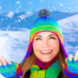 Cheerful female catching snowflakes — Stock Photo