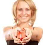 Happy woman giving gift box — Stock Photo