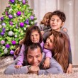 Happy family near Christmas tree — Fotografia Stock  #37265681