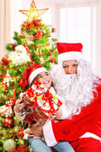 Receive gift from Santa Claus — Stock Photo