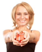 Happy woman giving gift box — Stock Photo