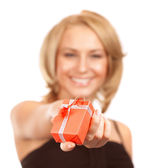 Happy woman offers gift box — Stock Photo