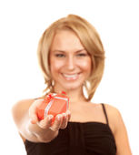 Smiling girl with gift box — Stock Photo