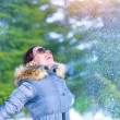 Happy woman throwing snow — Stock Photo