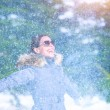 Excited female under snowfall — Stock Photo