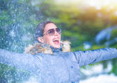 Playful woman on winter park — Stock Photo