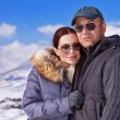 Beautiful couple on winter vacation — Stock Photo