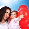 Stock Photo: Loving mother with baby