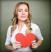 Loving woman with red heart — Stock Photo