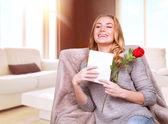 Happy female enjoying greeting card — Stock Photo