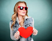 Cute girl with red heart — Stock Photo