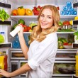 Woman chosen milk in opened refrigerator — Stock Photo #40810229