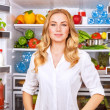 Healthy woman near open fridge — Stock Photo #40810675