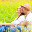 Happy couple on floral field — Stock Photo #41291987