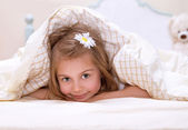 Little girl in the bed — Stock Photo