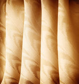 Beautiful golden curtains — Stock Photo