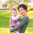 Stock Photo: Mother with daughter outdoor